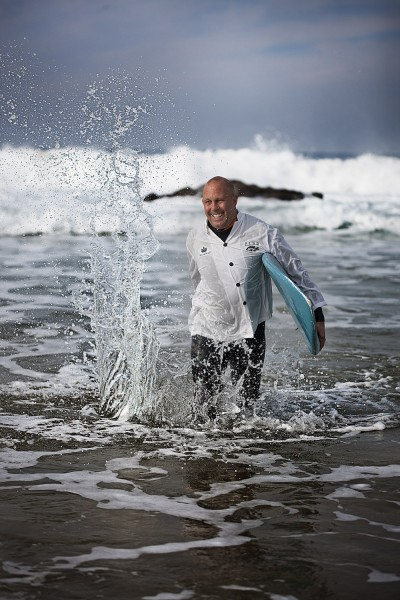 Steven in surf in jacket in portugal